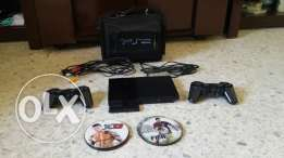 Ps2 with 2 hands and 12 Cds