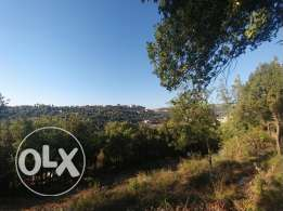 Land in Jbeil-Amchitt directly beside main road ! ! !