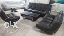 full salon black leather with center table .