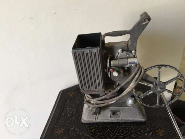 Family Antique 8 milimiter projector , 1940's $ 200