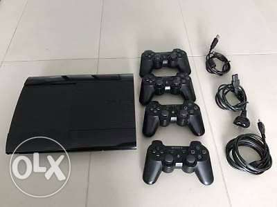 ps3 with 4 controllers and 3 games