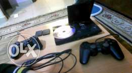 playstation2 , 2 joysticks with 2 8mb memory cards, ndife m3addale