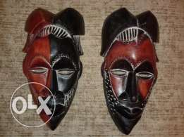 two african carved wooden masks 30cm approx