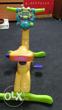 V tech Giraffe bicycle