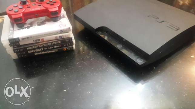PS3 with controller, wires and 5 games
