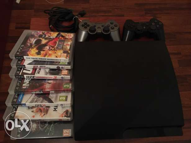 PS3 slim +1 colored controller+ 6 Games