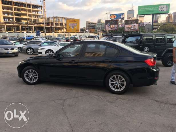 BMW 320 Black 2012 Fully Loaded in Showroom Condition! بوشرية -  3
