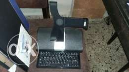Docking station with speakers and keyboard for ipad