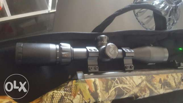 scope as good as new with lazer pointer