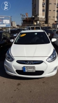 Hyundai Accent 2013 f.o + ABS sensor white like new