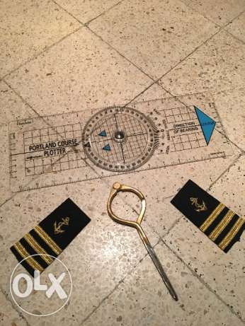 Navigation rule , marine devider , and captain shirt logo . المرفأ -  1