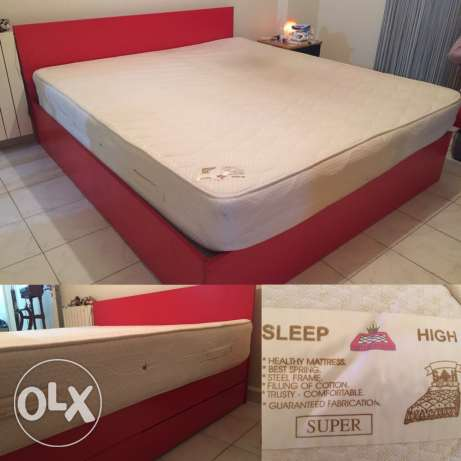 Red double bed with high quality mattress