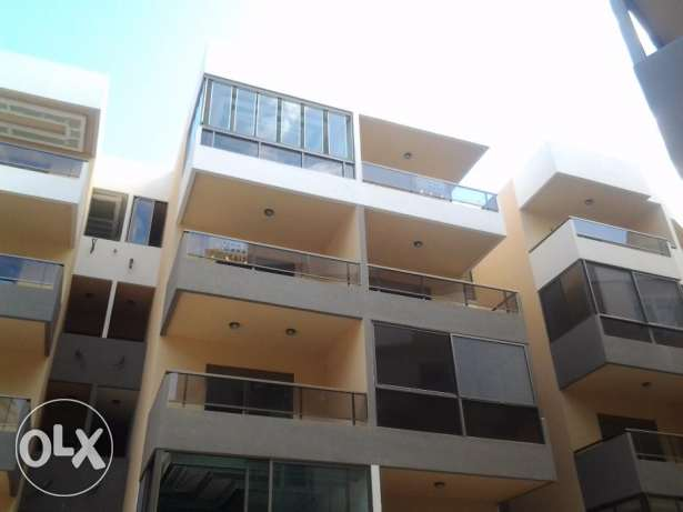 Zouk mosbeh apartment close to NDU with two parking .