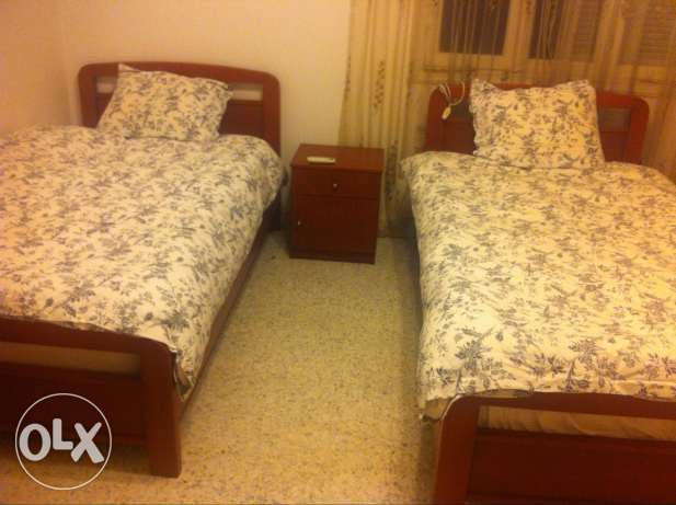 Bed room (2 beds and 1 side table) حازمية -  1
