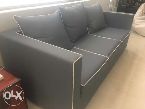 beautiful grey sofa with white piping in excellent condition