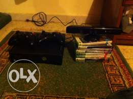 Xbox 360 with 2 controller & Camera & 8 Cds