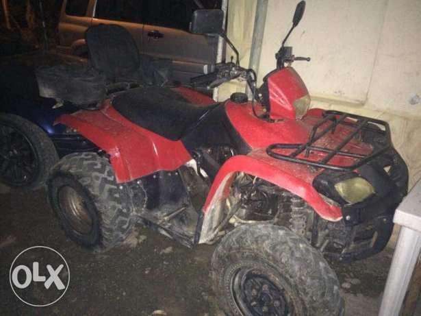 Atv red in good condition !