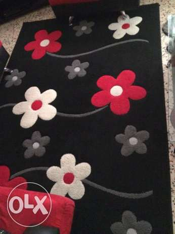 Black white and red Rug set