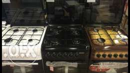 gas oven 4 eyes ( new in box)