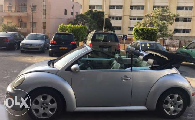 convertible gray beetle 2003 ((negotiable price))