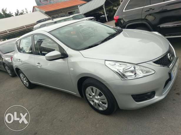 Nissan tiida 2014 fully loaded 27000 km only like new
