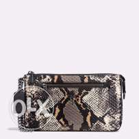 Coach Nolita Wristlet in exotic embossed leather Comes with a gift bag