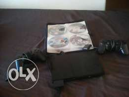 Play station 2 with 2 consols 1 memory andy 40 cd in bag