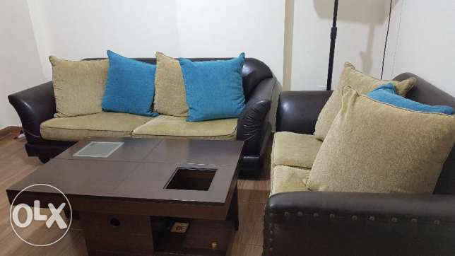 Furniture 2 sofas + table 300$ ( brown leather and beige)