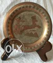 Antique Egyptian plate designed and naturally colored from red copper