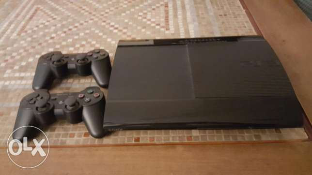 PS3 with Camera, 2 controllers and 7 games, as great as new for 200$. برج حمود -  1