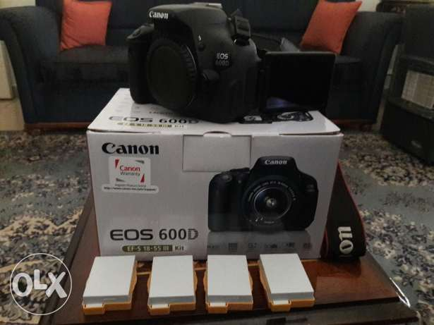 canon 600d body +50mm 1.8 + fash +32gb +5 battery +tripod all like new