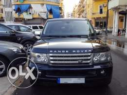 2009 Range Sport Supercharged DarkBlue/Beige Company Sourceمصدر الشركة