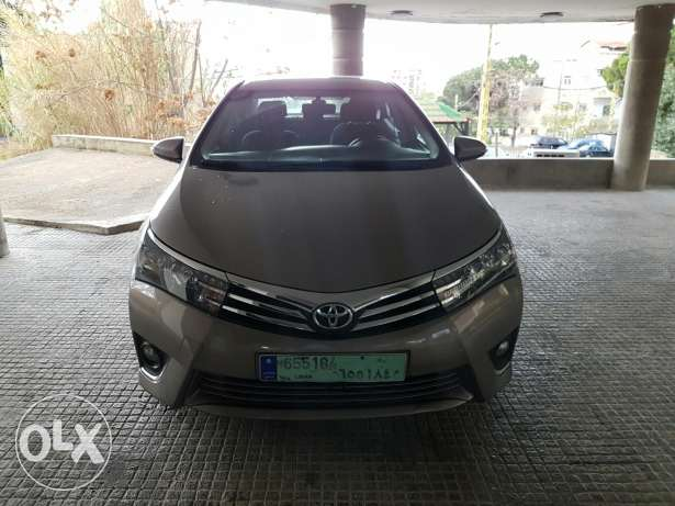 toyota corolla 2014 superior package still under company warranty . حارة حريك -  4