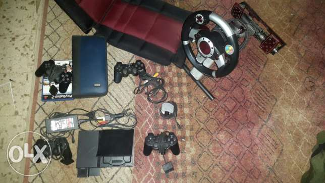 Ps2 full package and accessories (games,steering wheel, pedals,a seat)