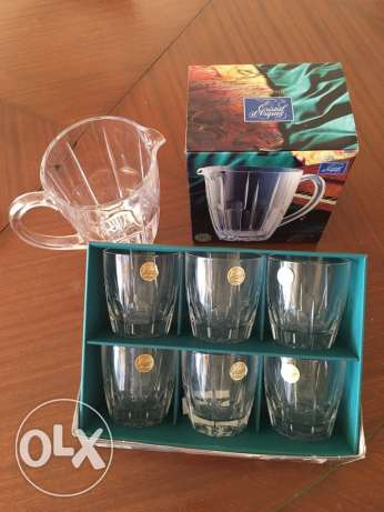 12 whisky ( cristal d'Arques) glasses plus a jar