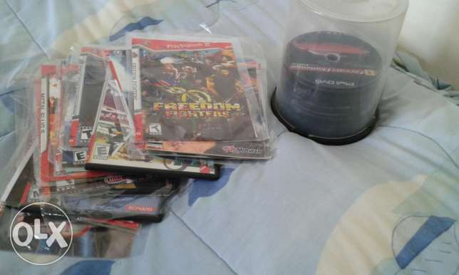 PlayStation 2 sony with 50 cd, 20 new cd, camera game, memory card 8MB