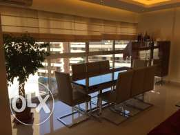 Modern dining table with 8 chairs and high buffet