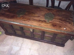 A solid wood with copper box
