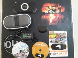 Original Black sony Psp 2000 with extra accessories.
