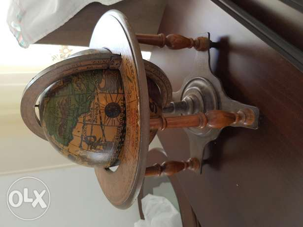 Antique globe and wooden cups n bottle