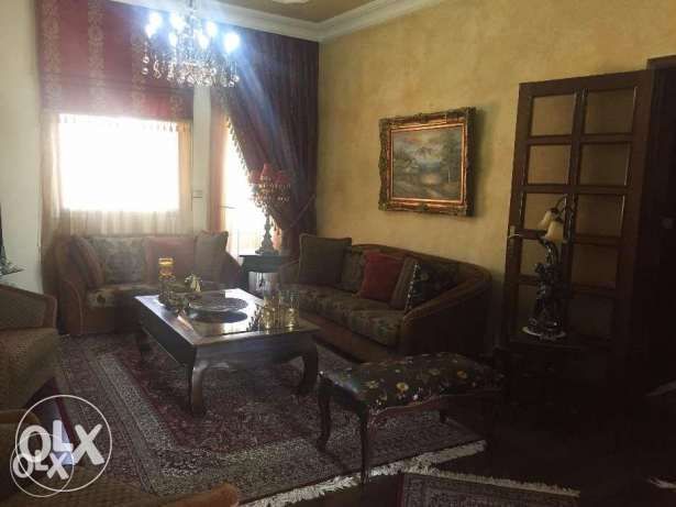 Ain el ghossein fully decorated apartment for sale .