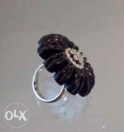 Onyx diamond and gold ring
