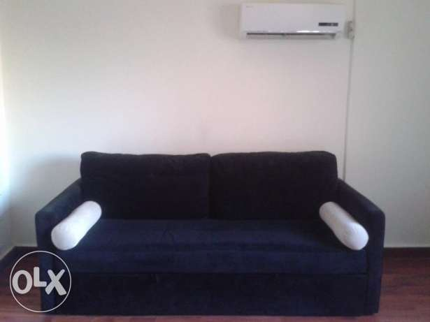 sofa bed - black comfy - like new