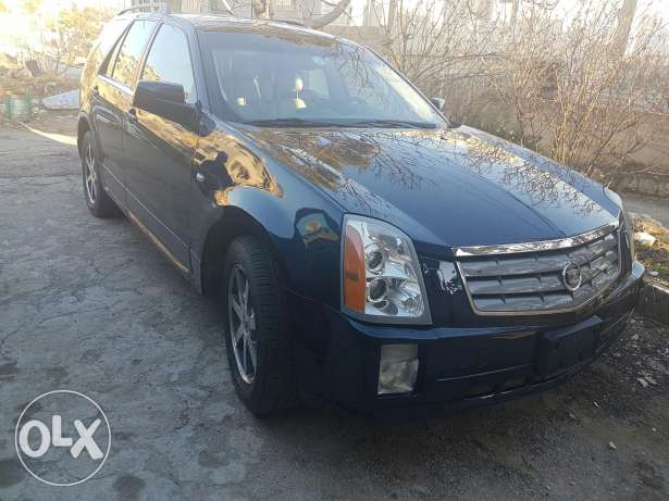 SRX 7 seats 4*4 for sale or trade