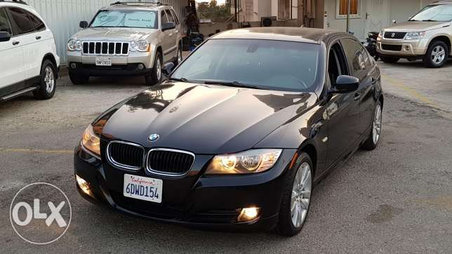 328i 2009 black/black for sale ajnabiyye