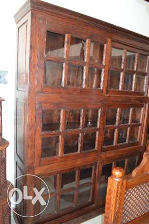 a solid wood cupboard with shelves