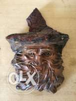 hand sculptured face on wood