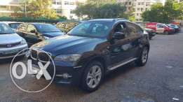 BMW X6 مصدر و صيانة الشركه M.2009 Black on black one owner super clea