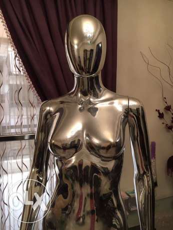 one stainless steel stand and two mannequins