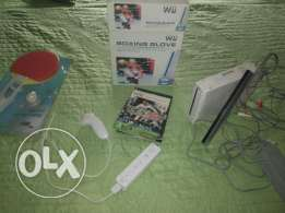 Wii + 10 cd + car wheel and boxing gloves and tennis